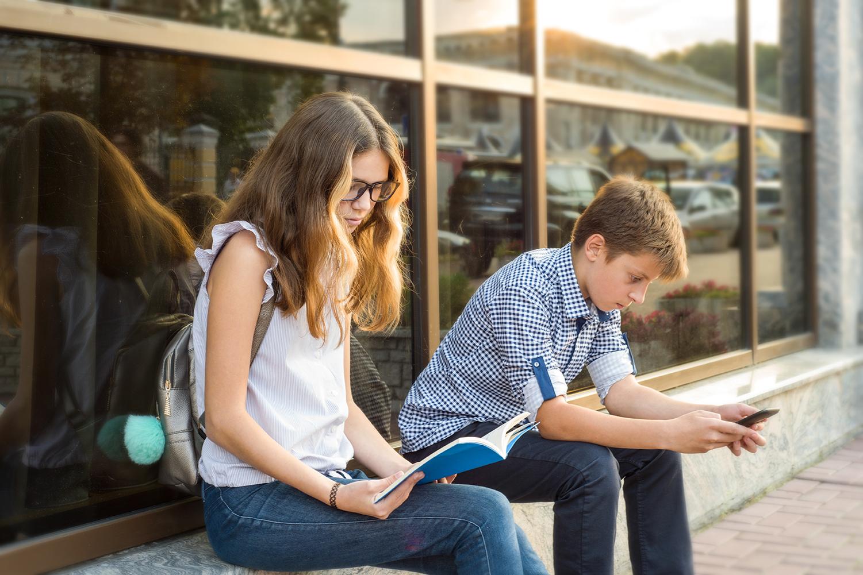 Children teen reading phone