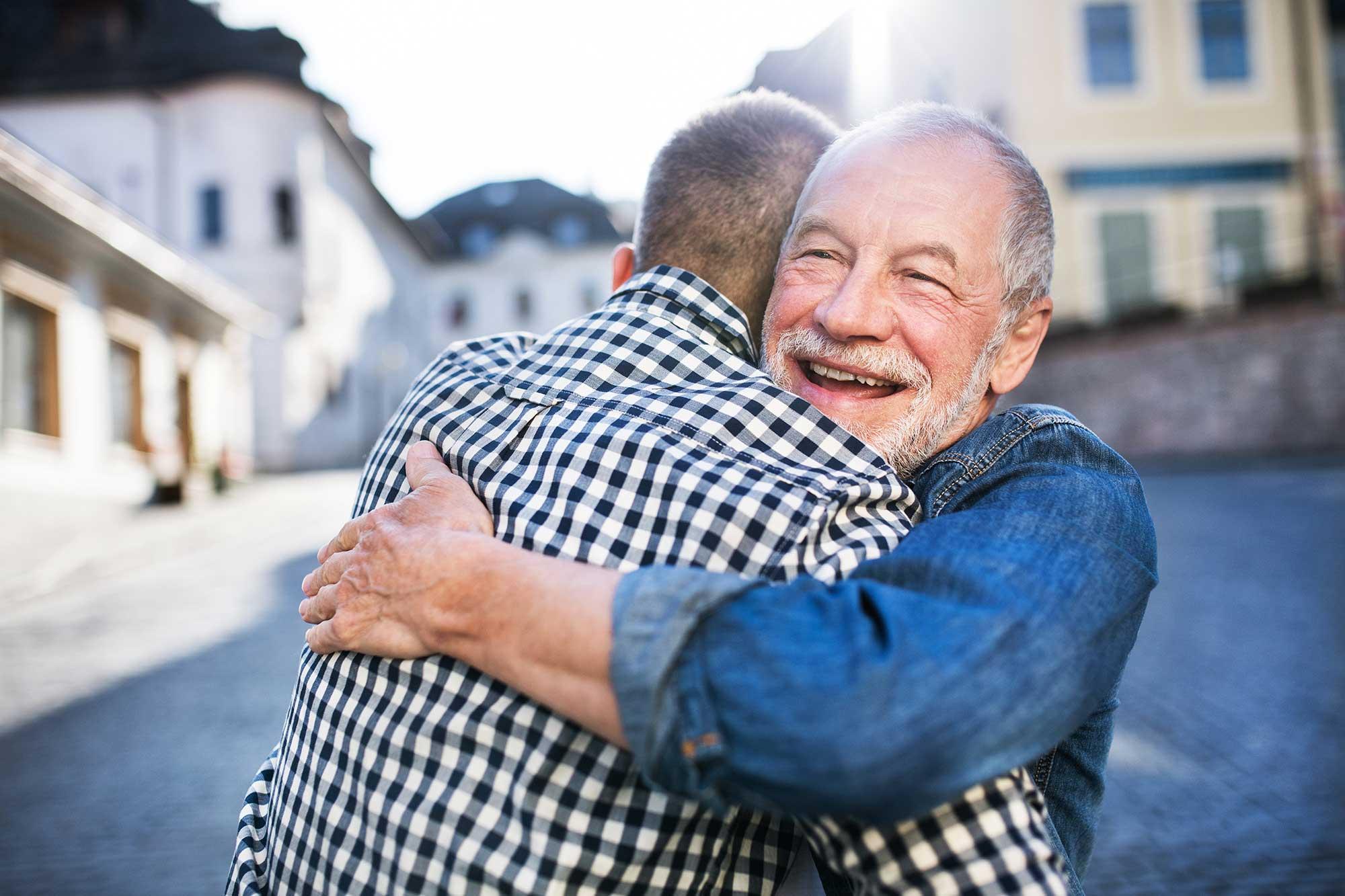 Men hugging and happy